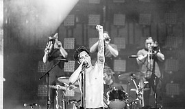 Promotional photo of Brendon Urie of Panic! at the Disco performing.