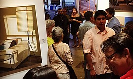 Photo of people in the Art Produce gallery, viewing an exhibit.