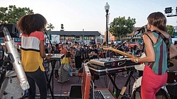 A photo of a band performing at Art Around Adams.