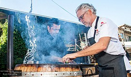 Contestants cook at the iQ Barrel Smoker Dinner Series.