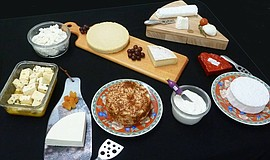Photo of cheeses and cheese-making tools.