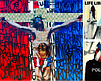"""A poster featuring artist Chor Boogie's The Ultimate Sacrifice and The Pursuit of Happiness, both 96"""" x 96"""", 2012, courtesy of Mesa College."""