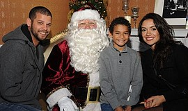 Promotional photo of participants at the Little Italy Christmas Village.