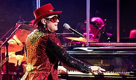 Promotional photo of Craig A. Meyer aka Almost Elton John performing on a pia...