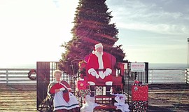 Promotional photo of pictures with Santa at Christmas on Crystal Pier.