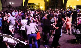 Promotional photo for Musica en la Plaza, featuring community members dancing...