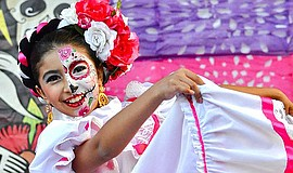 Promotional photo of a Dia entertainer. The Dia De Los Muertos at Mission San...