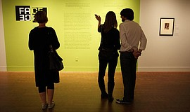 Promotional photo of patrons viewing an exhibit at the Museum of Photographic...