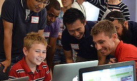 Promotional photo of participants for the Coding Faire At UC San Diego event.