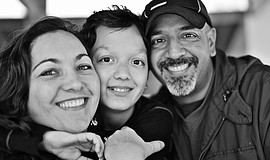 Promotional photo of a family. Courtesy of San Diego Cooperative Charter Scho...