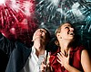 Promotional photo of a couple enjoying a fireworks show abroad a Hornblower yacht. Courtesy of Hornblower Cruises & Events.
