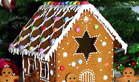 Promotional photo of a gingerbread house for Hotel del Coronado's Gingerbread...