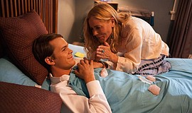 Film still featuring Johnny Simmons as Dr. Peter Newmans and Maria Bello as B...