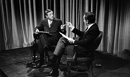 "Film still featuring William F. Buckley and Gore Vidal in ""Best of Enemies."""