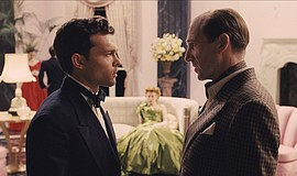 "Promotional film still featuring Alden Ehrenreich and Ralph Fiennes in ""Hail,..."