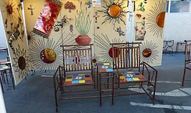 Promotional photo of a booth at the Harvest Festival Original Art & Craft Show.