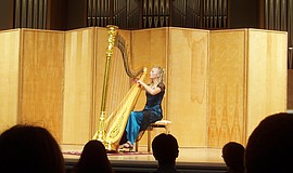 Harpist Laura Vaughan performs.