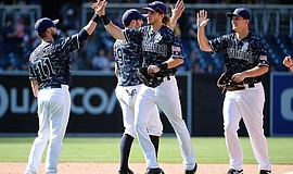 Travis Jankowski giving his teammate Ryan Schimpf a high-five. Photo courtesy of the Padres' Instagram.