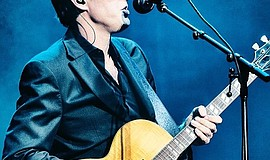Promotional photo of Joe Bonamassa performing.