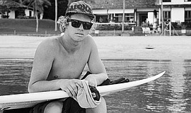 Promotional photo of John John Florence with a surfboard. A special screening...