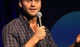 Promotional photo of Jon Rudnitsky. He will perform at The American Comedy Co...