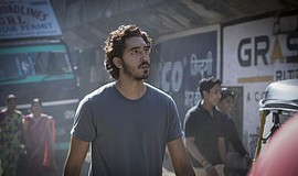 "Film still featuring Dev Patel as Saroo in ""Lion."""