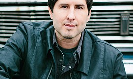 Promotional photo of Newbery Medal winner Matt de la Peña. He will lecture at...