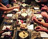 Promotional photo of guests eating entrees at The Melting Pot. Courtesy of The Melting Pot.
