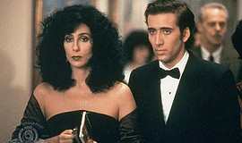 "Film still featuring Cher and Nicholas Cage in ""Moonstruck."""
