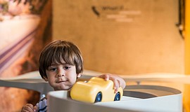 Photo of a child playing with a toy car, courtesy of the New Children's Museum.