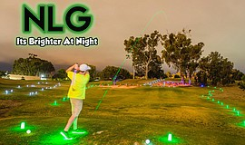 A golfer swings at the LED Night Golf Festival. This year's festival will be ...