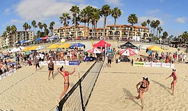 Promotional photo of a women's volleyball match at Pacific Beachfest. Courtes...