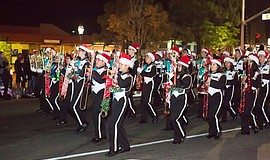 Promotional photo of a marching band at the annual Chula Vista Starlight Parade.