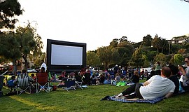 Families enjoying Summer Movies in the Park. Courtesy of Summer Movies in the...