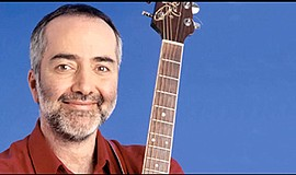 A promotional photo of children's entertainer Raffi.