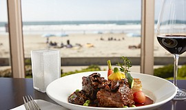 Promotional photo of The Shores Restaurant short ribs entree. The Shores Rest...