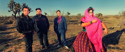 Promotional photo of La Santa Cecilia band members.