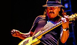 Promotional photo of Santana performing.