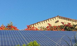 Promotional photo of Sullivan Solar Power's panels on a home.