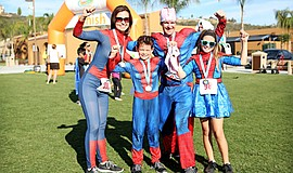 Promotional photo of a participants at the Super Hero Obstacle Race.