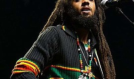 Photo of a member of The Wailers performing.