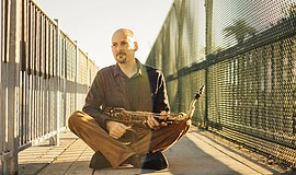 Promotional photo of Ian Tordella with his saxophone. He is one of four artis...