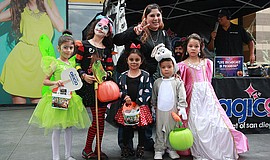 Participants at the Magic 92.5's Trick or Treat on Magic Street annual event.
