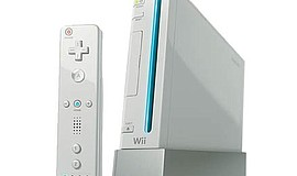 Photo of a Wii console and controller.
