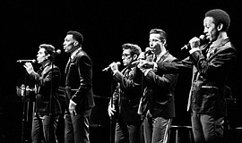 Promotional photo of The Doo Wop Project performing.