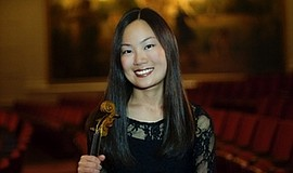 Promotional photo of violinist Yumi Cho. She and other San Diego Symphony mem...