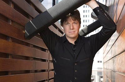 A photo of violinist Joshua Bell, courtesy of Academy of ...
