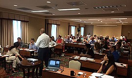 Promotional photo of previous seminar. Courtesy of Global Compliance Panel.