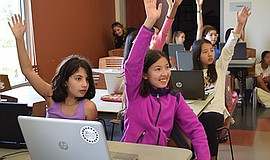 Promotional photo of girls participating in All Girls STEM Society event. Cou...