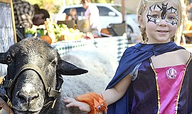 Promotional photo for the Howl-O-Ween Harvest Family Day at Helen Woodward An...